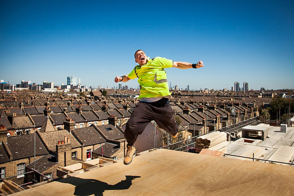 Happy and unsafe construction worker (Fall Hazard)